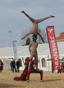 A troupe of acrobats entertain the crowd gathered on the Transnet Village Green, not far from the beer tent.