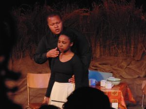 Ayanda (Tiisetso Mashifane) being hypnotised by the preacher (Sisesakhe Ntlabezo). Photo: Thato Tsotetsi / Artsvark