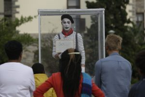 Mime Artist Richard Antrobus puts on a performance in a see through box during his 'Suggestion Box #justsaying' piece near the Drostdy Arch during the National Arts Festival 2015 in Grahamstown, PICTURE: MARK WESSELS. 11/07/2015.