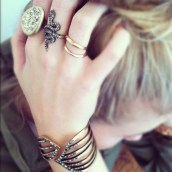 Ring finger- Gold + rose gold ring from try-tone set; Middle finger- Pave snake ring, Pointer- Oversized pave sculpted ring
