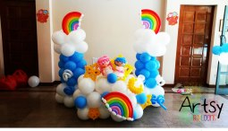 Balloon backdrop with 2 rainbow balloon columns at the sides