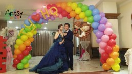Rainbow wedding balloon arch