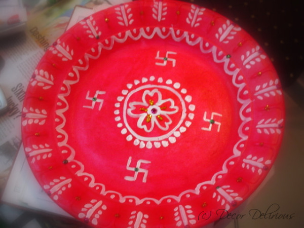 Ganesh Chaturti DIY aarti plate |via ArtsyCraftsyMom.com - Ganesh Chaturthi Crafts and Activities to do with Kids - Make a Clay Ganesha, decorate, Ganesha's throne & umbrella, rangoli ideas, recipes, books and more