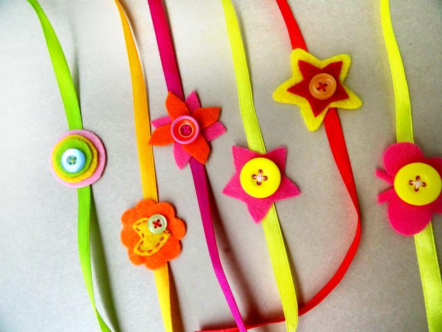 Cute Handmade Rakhis with buttons - We have 15 best ideas to make Rakhi at home for Rakshabandhan - Perfect rakhi ideas for kids to make, rakhi competition, best of waste, simple and handmade with detailed step by step images- ArtsyCraftsyMom