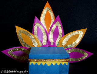 Ganesha-Seat-craft - via ArtsyCraftsyMom.com - Ganesh Chaturthi Crafts and Activities to do with Kids - Make a Clay Ganesha, decorate, Ganesha's throne & umbrella, rangoli ideas, recipes, books and more