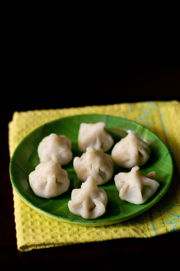 ukadiche modak recipe, steamed modak recipe, modak recipe - via ArtsyCraftsyMom.com - Ganesh Chaturthi Crafts and Activities to do with Kids - Make a Clay Ganesha, decorate, Ganesha's throne & umbrella, rangoli ideas, recipes, books and more