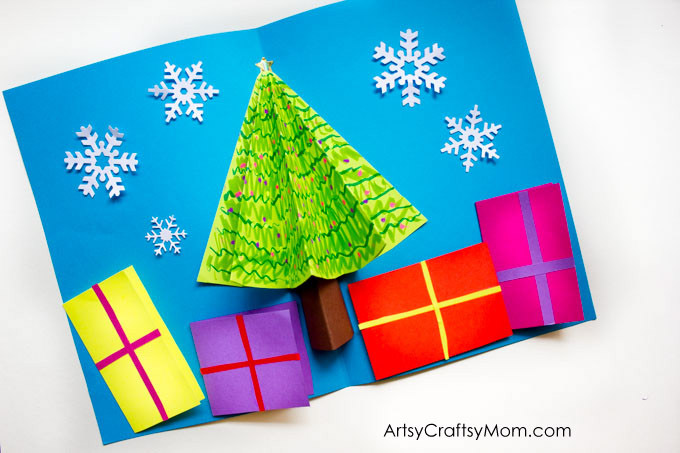 You can easily make your own 3D Christmas Tree Pop Up Card for family members and friends. Miniature presents hold your season's greetings at the bottom.