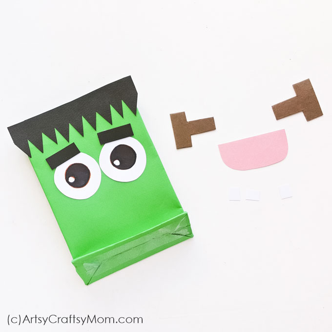 Don't forget to take along this DIY Frankenstein Treat Bag when you go trick o' treating on Halloween! Print out the templates, fix on the bag & it's done!