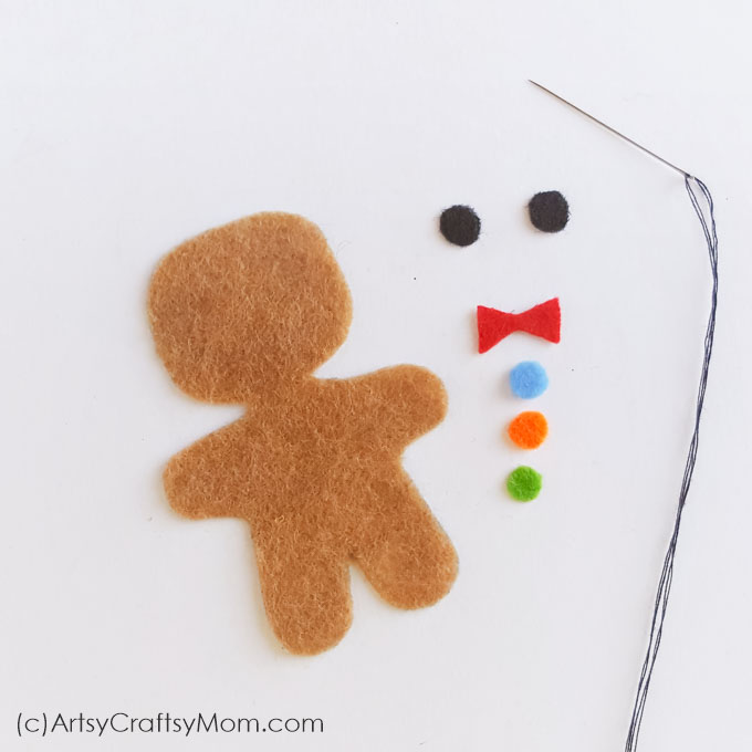 This Felt Gingerbread Man Christmas Ornament is as cute a button and pretty simple to make! Hang it on your tree or gift it to a special friend!