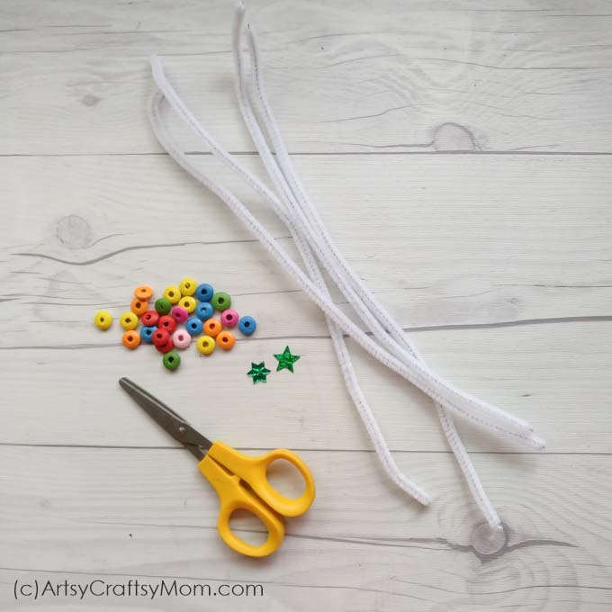 Dreaming of a white Christmas? Make it come true with our White Pipe cleaner Christmas Tree Ornament Craft! Super easy to make with just a few supplies!