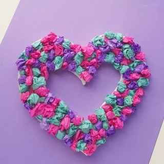 Make this beautiful Crepe Paper Heart Wreath that's perfect for Valentine's Day!! Use it as Valentine decor or as a cute little gift to give your Valentine!