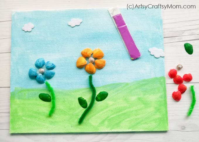 Collected shells while on holiday? Put them to use by making this beautiful Seashell Flower Garden Craft! Super easy craft that even young kids can make!