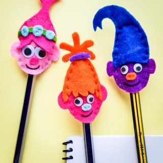 Need a cute back to school gift? These Troll Inspired Felt Pencil Toppers are just what you need! Personalize by using the colors of your favorite troll!