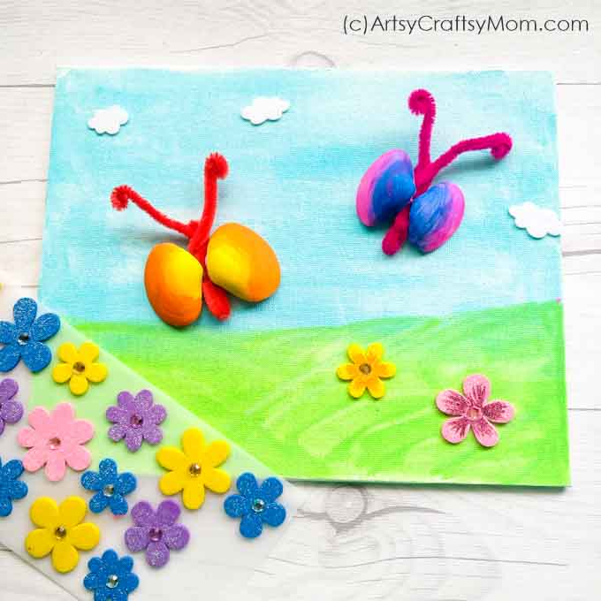Longing for spring? Get ready with this simple and pretty Seashell Butterfly Craft for kids. All you need are shells, pipe cleaners & basic craft supplies!