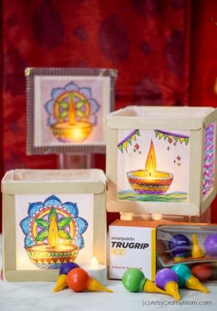 Make Colorful Diwali Popsicle Stick Lanterns or Paper luminaries using wax paper, popsicle sticks, and some beautiful Diya art!