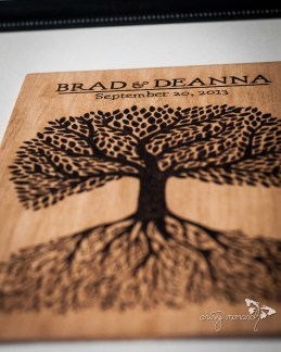 The guestbook was a framed wood burning with their names and wedding date with a matte around the outside for guests to sign.