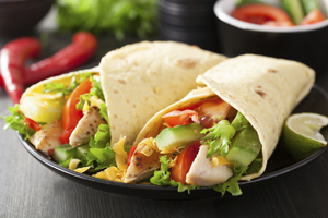 Grilled Fajita Chicken Taco ~ Crisp flour tortilla filled with chorizo, chicken, or ground beef, with lettuce, tomato, cheese, hot sauce, and onion.