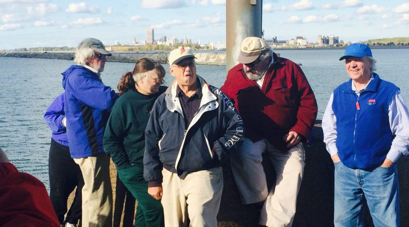 Coppola with Bill Zimmerman, of Seven Seas Sailing School; and Mark Vogel, the esteemed journalist and preservationist; looking towards downtown from the South Buffalo Lighthouse.
