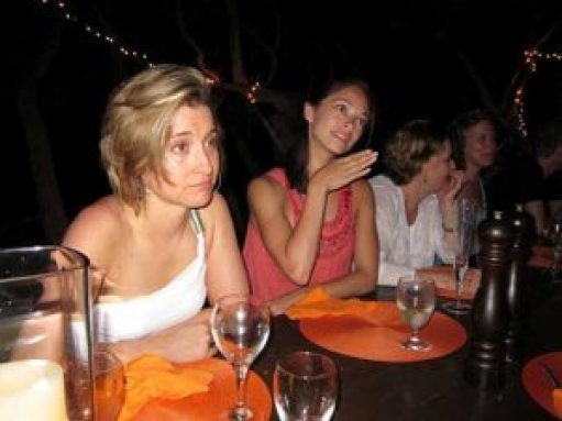 At a secret week long gathering in Necker Island, NXIVM women imbibe liquor and learn the secrets of their master, Keith Raniere. If the two women closest to the camera look familiar it is because you may have seen them on TV; They are acresses Kristin Kreuk and Allison Mack, long-time devotees and purported harem members.