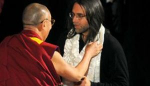 The Dalai Lama places the white scarf of purity on Keith Raniere