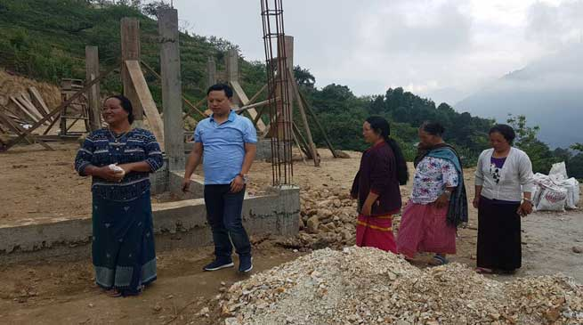 Kumsi Sidisow inspects various ongoing projects