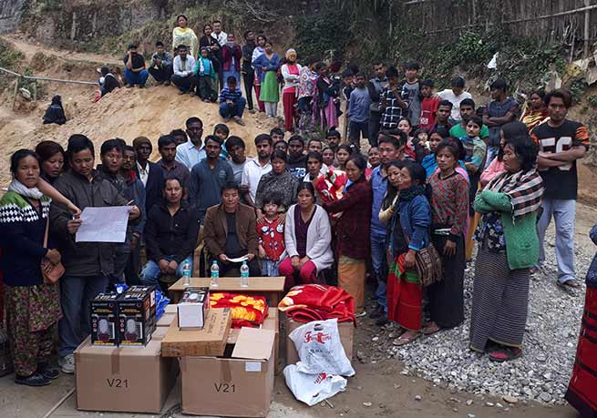 Itanagar: Jalley Sonam distributes relief materials to the fire victims