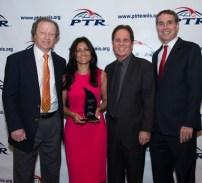 Photo from left: PTR Board President Roy Barth, Aruna Bernier, PTR Foundation Chair Scott Tharp and PTR CEO Dan Santorum