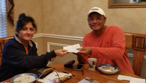11/08/2016 handing donation checks to coach Lama for Project Nepal