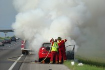 Trying to douse fire inside the car