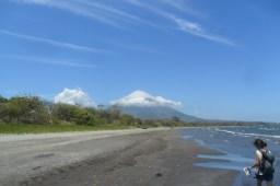 """Volcano Concepción... its peak wearing a sombrero of white clouds."""