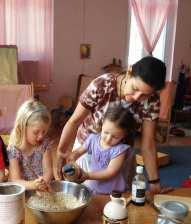 Waldorf Kindergarten children in the Afternoon Program baking cookies