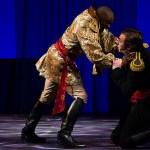 Othello grabbing Iago by the throat