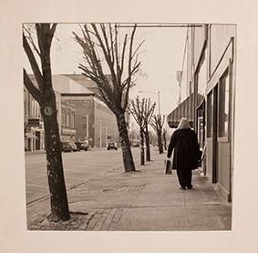 Photo of woman walking down street.