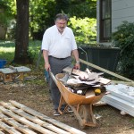 Dean Robert Olin pushing a wheelbarrow
