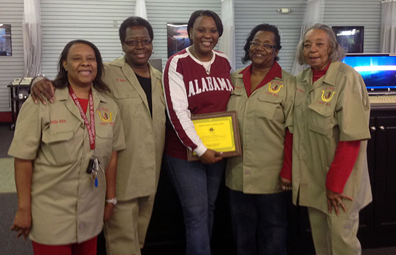 Dr. Rosianna Gray (pictured at center), an assistant professor in the Department of Biological Sciences, is presented with a certificate of appreciation from (left to right) Delitha McTerry, Annette Taylor, Jennette Grant, and Catherine Spencer, members of the Daughters of Isis contributions to their annual holiday tor drive.