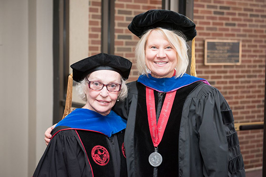 Ph.D. recipient Dorothy Franklin (left). Natalie Adams, New College Director (right).