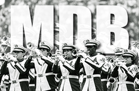 members of the Million Dollar Band, in a photo from the 1970s that shows their cool retro uniforms