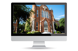 computer monitor with a picture of Clark Hall