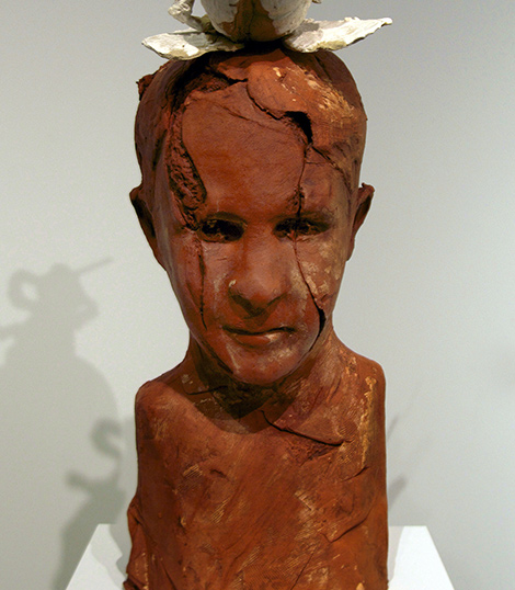 brick-red sculpture of a human head