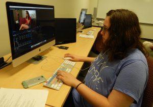 A camp participant edits her film using a computer.