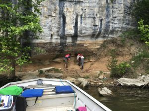 Dr. Gary Stinchcomb, of Murray State University, right, and Dr. Matthew Therrell, of The University of Alabama, examine a paleoflood deposit trapped under a rock overhang on a bluff of the Tennessee River.