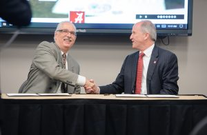 UCAR President Antonio Busalacchi shakes hands with UA President Stuart Bell