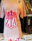 Pink breast cancer ribbon badge, T-shirt showcasing the five-pointed crown, which is the official symbol of Zeta Tau Alpha.