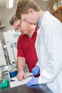 Dr. Guy Caldwell, left, and doctoral student Brucker Nourse are studying genetic resiliency to Parkinson's.