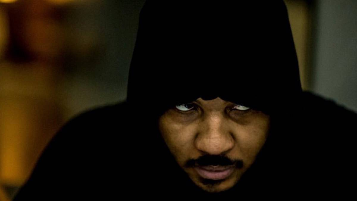 Carmelo Anthony under a black hoodie
