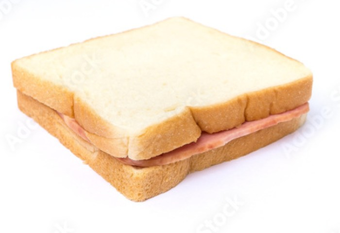 Sliced White Bread With Ham Sandwich On White Background Buy This