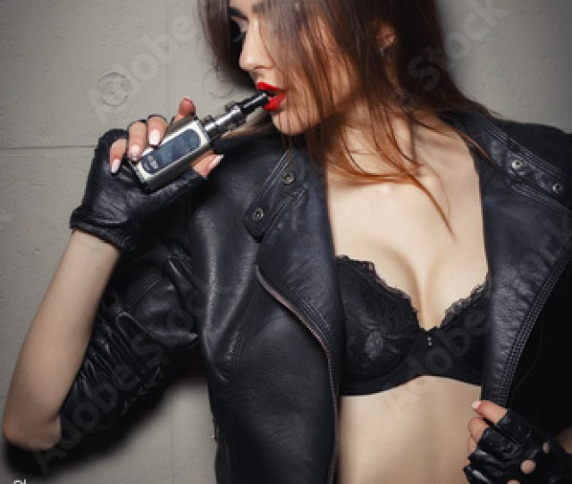 Modern Gadget For Smokers Young Pretty Woman Smoking E Fag Wearing Black Leather Jacket