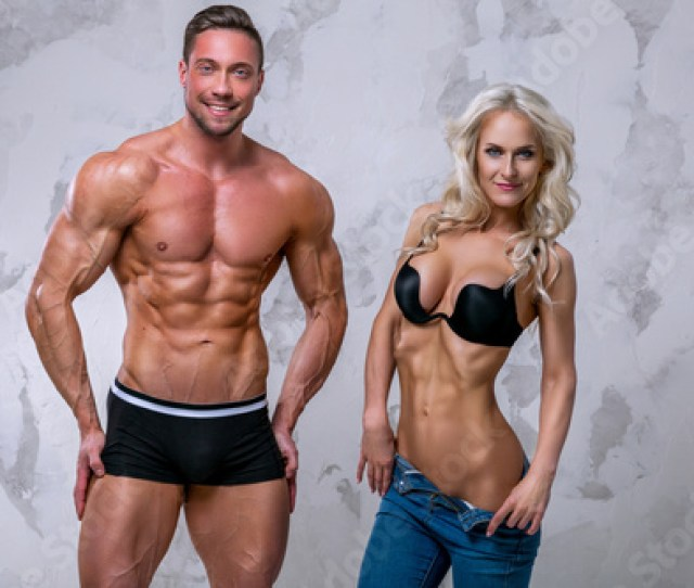 Strong Healthy Handsome Athletic Man And Sexy Girl Posing In The