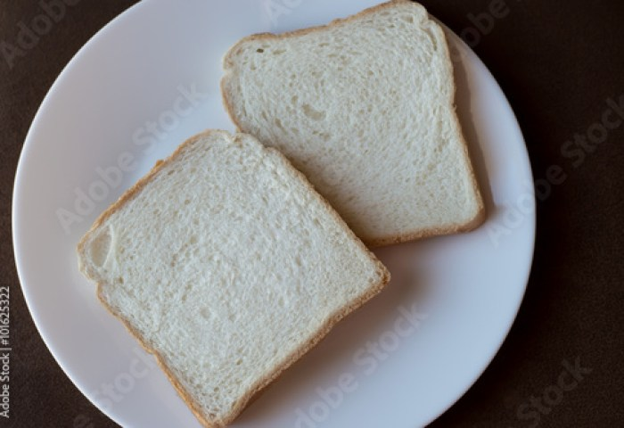 2 Slices Of White Bread On A White Plate Buy This Stock Photo And