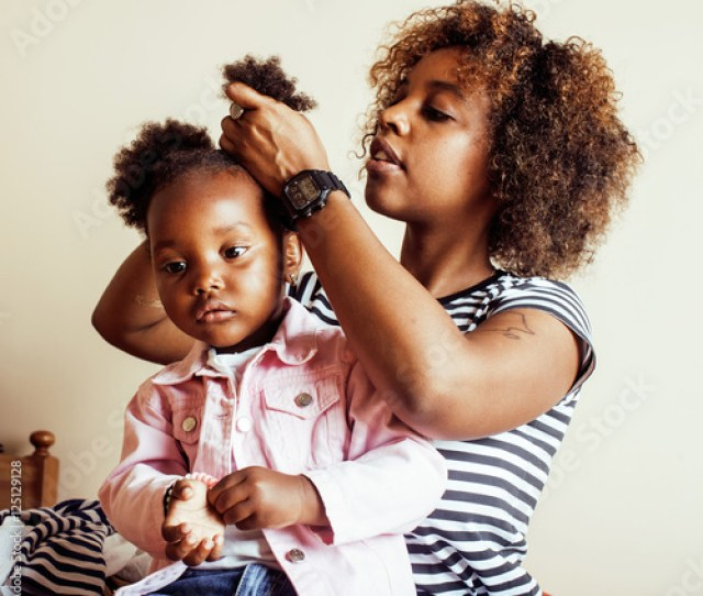 Modern Young Happy African American Family Mother Combing Daughters Hair At Home Lifestyle People Concept